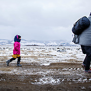 In subfreezing snowy weather, refugees walk the official-unoffical refugee crossing from the Tabanovce, Macedonia Train Station across the Serbian border.  Near Miratovac, Serbia, January 2016.