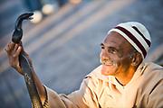 a snake charmer in Djemaa el fna in marrakech morocco