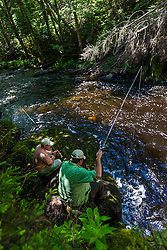 Two men fly-fishing below Cold Stream Falls in Maine's Northern Forest. Cold Stream Gorge. Johnson Mountain Township.