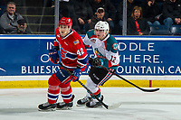 KELOWNA, BC - MARCH 13: Cole Carrier #12 of the Kelowna Rockets back checks Egor Arbuzov #42 of the Spokane Chiefs at Prospera Place on March 13, 2019 in Kelowna, Canada. (Photo by Marissa Baecker/Getty Images)