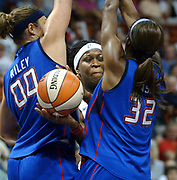 Spt6/25/04  Photo by Mara Lavitt--Sun/Schock<br /> ML0139EF #4205<br /> 1st Half at the Mohegan Sun Arena, Uncasville:  Sun's Taj McWilliams-Franklin keeps the ball free between Shocks Ruth Riley left and Swin Cash right.