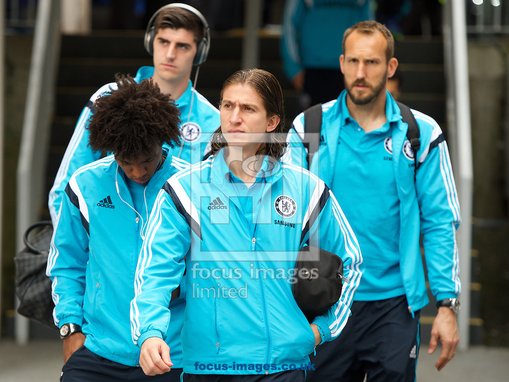 Filipe Luis ( fore-ground) of Chelsea arriving with Willian (left) goalkeeper Thibaut Courtois  and goalkeeper Mark Schwarzer for the Barclays Premier League match at Selhurst Park, London<br /> Picture by Alan Stanford/Focus Images Ltd +44 7915 056117<br /> 18/10/2014