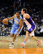 Nov. 12, 2012; Phoenix, AZ, USA; Denver Nuggets guard Andre Miller (24) handles the ball against the Phoenix Suns guard Goran Dragic (1) during the first half at US Airways Center. The Suns defeated the Nuggets 110-100. Mandatory Credit: Jennifer Stewart-US PRESSWIRE