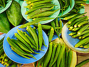 02 SEPTEMBER 2015 - BANGKOK, THAILAND: Okra for sale in the Bang Chak Market. The Bang Chak Market serves the community around Sois 91-97 on Sukhumvit Road in the Bangkok suburbs. About half of the market has been torn down, vendors in the remaining part of the market said they expect to be evicted by the end of the year. The old market, and many of the small working class shophouses and apartments near the market are being being torn down. People who live in the area said condominiums are being built on the land.         PHOTO BY JACK KURTZ