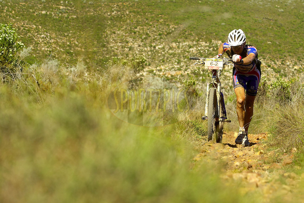 WESTERN CAPE, SOUTH AFRICA -  30 March 2008, Massimo Debertolis of Full-Dynamix RSM climbs the Gamtaskloof during stage two of the 2008 Absa Cape Epic Mountain Bike stage race from Saasveld Campus Nelson Mandela Metropolitan University in George to Calitzdorp Spa, Calitzdorp in the Western Cape, South Africa..Photo by Gary Perkin/SPORTZPICS