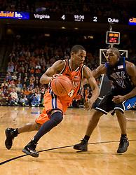 Virginia guard Sean Singletary (44) dribbles past Duke guard DeMarcus Nelson (21).  The Virginia Cavaliers men's basketball team fell to the #6 Duke Blue Devils 86-70 at the University of Virginia's John Paul Jones Arena in Charlottesville, VA on March 5, 2008.