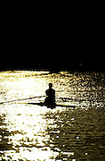 18/12/2002.Sport - Rowing.2003 Women's Boat Race.Cambridge Womens Boat Club Trail Eights Henley Reach.Single sculler against the setting sun Sunrise, Sunsets, Silhouettes