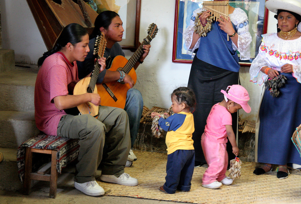 South America, Ecuador, Peguche. A family of Andean musicians make and play thier own instruments.
