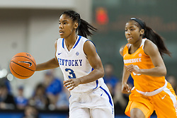 Kentucky guard Janee Thompson, left, looks for an open teammate in the first half.<br /> <br /> The University of Kentucky hosted the University of Tennessee, Monday, Jan. 25, 2016 at Memorial Coliseum in Lexington .