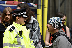 May 1, 2019 - London, Greater London, United Kingdom - Police officer is seen speaking with an Environmental activists during the protest outside the Brazilian embassy in London...Extinction Rebellion activists gathered outside Brazil embassy in London to celebrate the Amazon Rainforest's biodiversity and demand to stop the  rainforest exploitation and to protect it. (Credit Image: © Andres Pantoja/SOPA Images via ZUMA Wire)