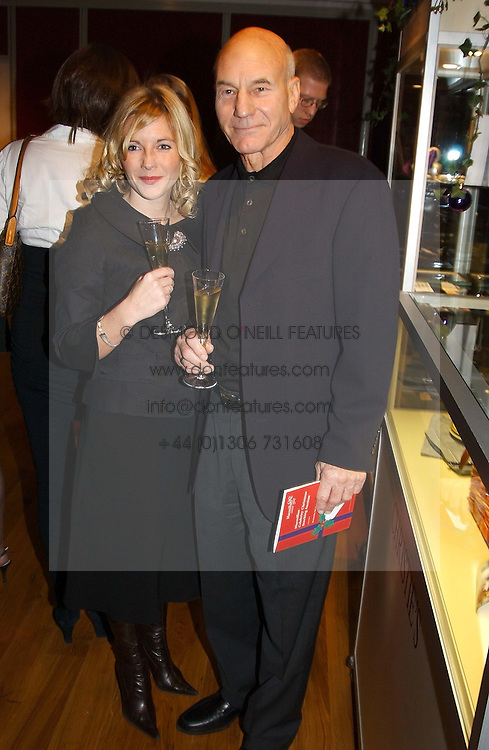 Actor PATRICK STEWART and close friend LISA DILLON at the Macmillan Cancer Relief Celebrity Christmas Stocking Auction held at Christie's, South Kensington, London on 8th December 2004.<br /><br />NON EXCLUSIVE - WORLD RIGHTS