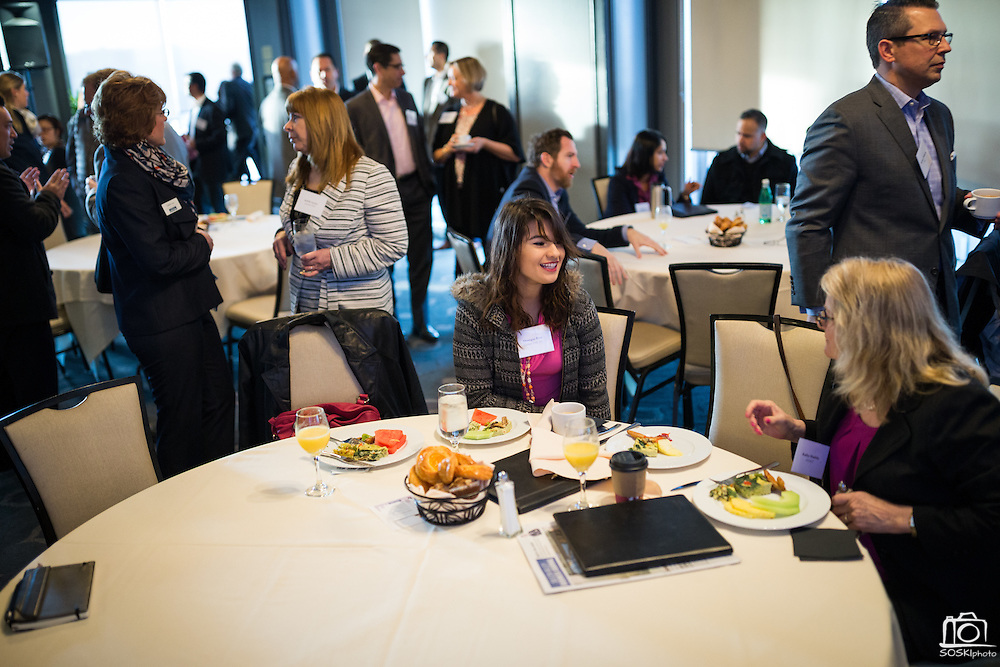Monique Ross, center, and others attendees network before the Silicon Valley Business Journal Power of Manufacturing Breakfast at the Silicon Valley Capital Club in San Jose, California, on January 24, 2017. (Stan Olszewski for Silicon Valley Business Journal)