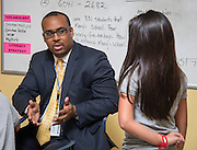 Tarrynce Robinson talks with sixth graders at Holland Middle School, September 4, 2014.