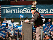 02 MARCH 2020 - ST. PAUL, MINNESOTA: MICHAEL FAIRBANKS, of the White Earth Band of the Ojibwa tribe, announces that the tribe is supporting Sen. Bernie Sanders for US President at a Bernie Sanders Get Out the Vote rally in the RiverCentre in St. Paul. More than 8,400 people attended the rally. Minnesota is a Super Tuesday state this year and Minnesotans will go to the polls Tuesday. Minnesota Sen. Amy Klobuchar was expected to win her home state, but she dropped out early Monday, March 2.        PHOTO BY JACK KURTZ