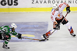Tomaz Vnuk of Olimpija and Sabahudin Kovacevic of Jesenice at ice hockey match ZM Olimpija vs  Acroni Jesencie in third round of final of Slovenian National Championship,  on April 8, 2008 in Arena Tivoli, Ljubljana, Slovenia. Acroni Jesenice won the game 1:2 and lead the series 3:0.  (Photo by Vid Ponikvar / Sportal Images)