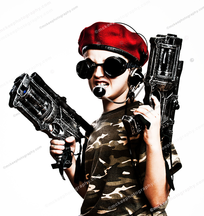 Attack! Camouflage boy with toy guns and a headset, probably calling in an air strike on his big brother who was hogging the tv remote