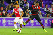 Flamengo midfielder Jean Lucas (18) and Ajax defender Lisandro Magallan (16) in action during a Florida Cup match at Orlando City Stadium on Jan. 10, 2019 in Orlando, Florida. <br /> Flamengo won in penalties 4-3.<br /> <br /> ©2019 Scott A. Miller