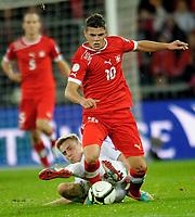 Bern, 12.10.2012, Fussball WM 2014 Quali, Schweiz - Norwegen, Granit Xhaka (SUI) gegen Ruben Yttergard Jenssen (NOR). (Daniel Christen/EQ Images)
