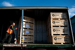 © London News Pictures. 14/11/2013. Bicester, UK. Humanitarian aid bound for Cebu, in the Philippines, being loaded onto lorries at the Oxfam Emergency Warehouse in Bicester, Oxfordshire. Cebu was one of the areas hardest hit by Typhoon Haiyan, which has killed thousands of people.  Photo credit: Ben Cawthra/LNP