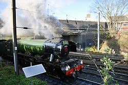 Flying Scotsman leaving Norwich station in front of solar panel Nov 2017 UK