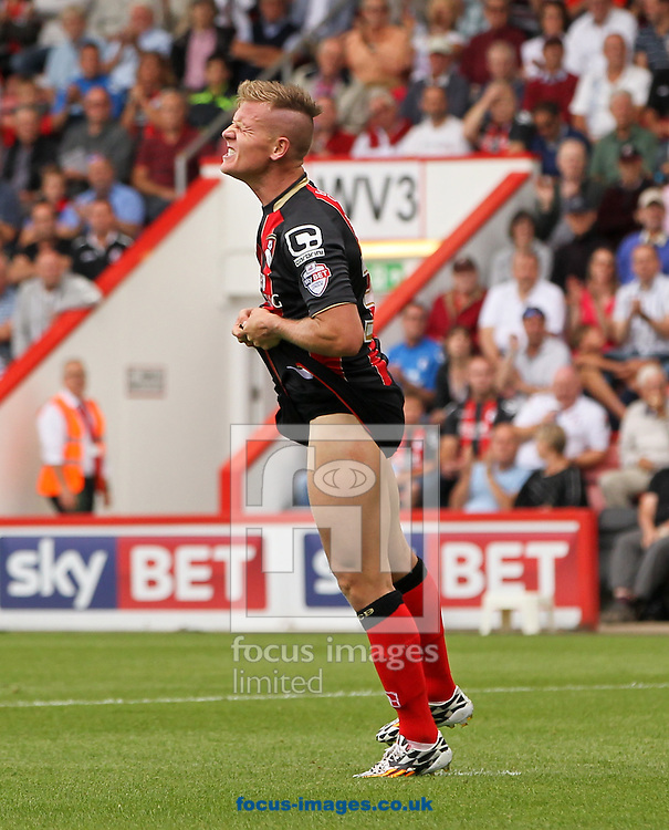 Matt Ritchie (centre) of Bournemouth reacts to missing a good chance to score during the Sky Bet Championship match at the Goldsands Stadium, Bournemouth<br /> Picture by Tom Smith/Focus Images Ltd 07545141164<br /> 16/08/2014