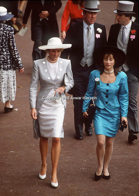 ASCOT - JUNE 11:  Diana, Princess of Wales, wearing a Catherine Walker outfit and a hat by Philip Somerville, chats to a friend at the Royal Ascot race meeting on June 11, 1988 in Ascot, England.  (Photo by Anwar Hussein/Getty Images) *** Local Caption *** Diana, Princess of Wales