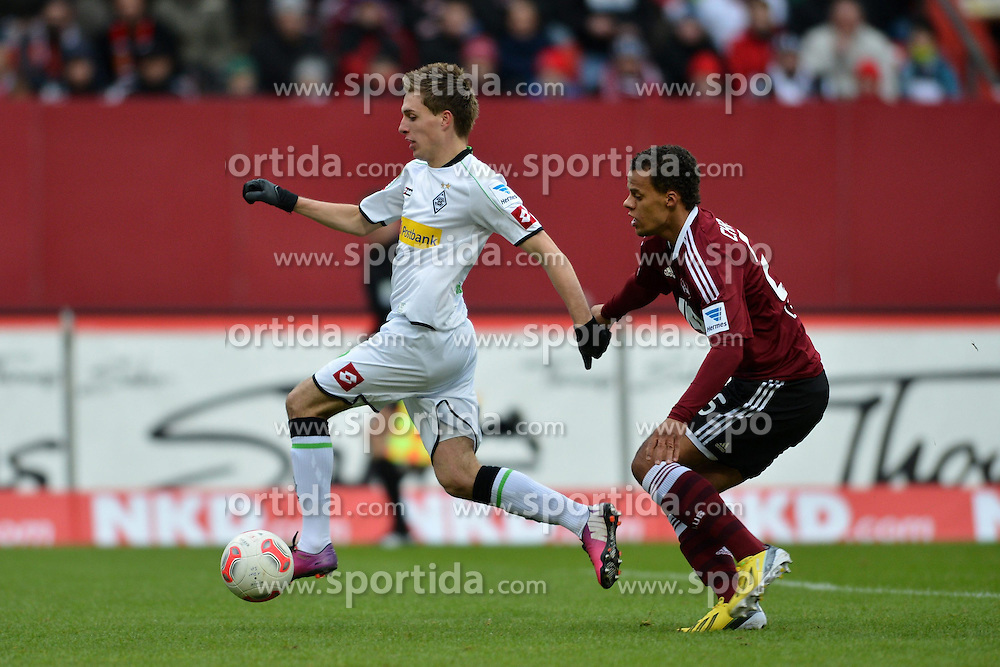 03.02.2013, easyCredit Stadion, Nuernberg, GER, 1. FBL, 1. FC Nuernberg vs Borussia Moenchengladbach, 20. Runde, im Bild Patrick HERRMANN (Borussia Moenchengladbach/ links) setzt sich gegen Timothy CHANDLER (1.FC Nuernberg/ rechts) durch. Action / Aktion // during the German Bundesliga 20th round match between 1. FC Nuernberg and Borussia Moenchengladbach at the easyCredit Stadium, Nuernberg, Germany on 2013/02/03. EXPA Pictures © 2013, PhotoCredit: EXPA/ Eibner/ Matthias Merz..***** ATTENTION - OUT OF GER *****