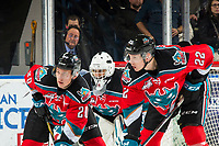 KELOWNA, CANADA - DECEMBER 7:  Roman Basran #30 defends the net as Conner Bruggen-Cate #20 and Braydyn Chizen #22 of the Kelowna Rockets line up for the face off against the Victoria Royals on December 7, 2018 at Prospera Place in Kelowna, British Columbia, Canada.  (Photo by Marissa Baecker/Shoot the Breeze)