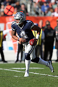Dallas Cowboys quarterback Dak Prescott (4) looks to hand off the ball on a running play during the 2016 NFL week 9 regular season football game against the Cleveland Browns on Sunday, Nov. 6, 2016 in Cleveland. The Cowboys won the game 35-10. (©Paul Anthony Spinelli)