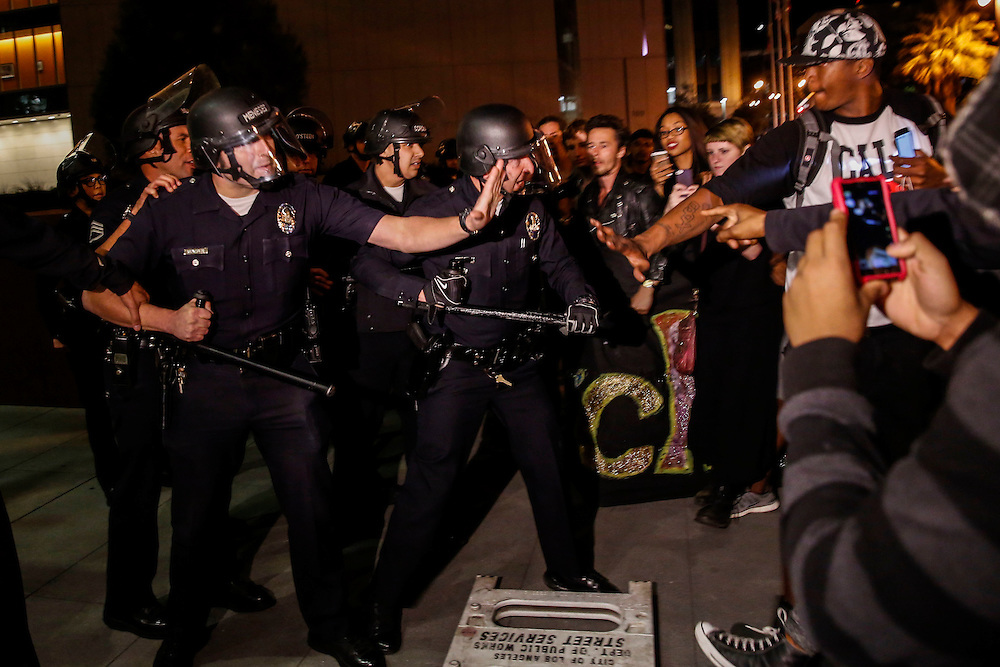 LAPD officers hold a skirmish line in front of the LAPD Headquarters as people protest the decision of the Ferguson grand jury and the death of Michael Brown on early morning Tuesday, November 25, 2014 in Los Angeles, Calif. (Patrick T. Fallon/ For the Los Angeles Times)