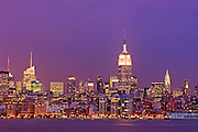 Panoramic skyline view of New York City, Manhattan at twilight, featuring, from left, One Bryant Park, the Empire State Building and the Chrysler Building, as seen from across the Hudson River.