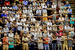 "People come together to sing ""We Shall Overcome"" during a community prayer and healing vigil Friday, June 19, 2015 at College of Charleston TD Arena. Paul Zoeller/Staff"
