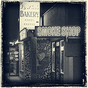 DeLeon's Bakery and a smoke shop along Chapman Ave in Fullerton, CA.