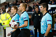 Match referee Oskari Hamalainen (FIN) with his 2 assistants, Sami Nykanen (FIN) & Ceyhun Sesiguzel (TUR) lead the teams out onto the pitch ahead of the U17 European Championships match between Portugal and Scotland at Simple Digital Arena, Paisley, Scotland on 20 March 2019.
