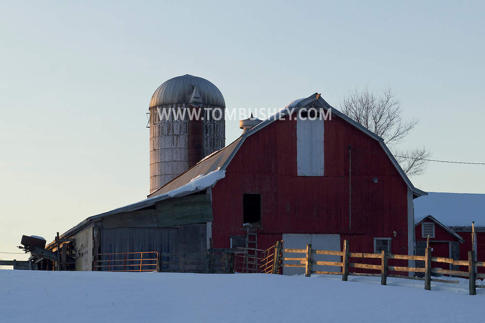 Goshen, New York - Late after noon sunlight shines on the fence by a barn on a farm on Feb. 10, 2013.