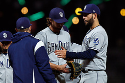 SAN FRANCISCO, CA - SEPTEMBER 24: Bryan Mitchell #50 of the San Diego Padres is relieved by Andy Green #14 during the ninth inning against the San Francisco Giants at AT&T Park on September 24, 2018 in San Francisco, California. The San Diego Padres defeated the San Francisco Giants 5-0. (Photo by Jason O. Watson/Getty Images) *** Local Caption *** Bryan Mitchell; <br /> Andy Green