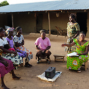 "Anita Sutha, a junior high school teacher by profession, also coordinates a number of women's groups in her area. She is seen with members of a ""susu"" group - an informal savings and loan club - that she coordinates in her home village of Gbengbee in the Upper West region of Ghana. She also acts as as an assistant to Pognaa Tang I:  a pognaa is responsible, in particular, for the wellbeing of women and children in her area of authority. While the title translates as ""woman chief"", in practice her authority is  subject to a male chief. The role of the pognamine (plural of pognaa) is being revived after having been suppressed during the colonial era, and they are increasingly seen as a force for development."