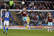 Michael Keane of Burnley and Anthony Pilkington of Cardiff City challenge for a high ball during the Sky Bet Championship match between Burnley and Cardiff City at Turf Moor, Burnley, England on 5 April 2016. Photo by Simon Brady.