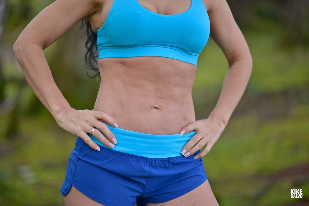Hispanic woman with sculpted abdomen.