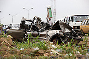 Thousands of undocumented people loose their lives in Nigeria from vehicle crash caused by human factors, such as bad roads, drunk-driving, overloading, poor vehicle maintenance, and excessive speeding. While the government and many international donor agency's spend vast amounts of money on various diseases, they spend little or no money on car accidents which claim more lives yearly than any of the diseases such as HIV AIDS, TB etc.<br /> <br /> Nigeria is a highly religious country and most people tend to put down all their misfortunes as the handiwork of the Devil. <br /> <br /> Devil's Dexterity is a body of work, which is taking on a more conceptual framework . The starting point is the remnants of accidents that are constantly seen on the Nigerian roads and roadside, and to explore the vulnerability of life and the tragic beauty of the landscape. I travelled part of the time with a model who I dressed up to look like a figurative Devil and lurk as the Devil is supposed to do around the accident scenes, with the vehicle and human remnants left abandoned by the local government on the roadside. These officials do not live up to their responsibility, and remove the carcasses and wrecks often for years and years. I do not mean to offend, but rather see these images as thought provoking and to inspire something deep within the mind of the viewer.