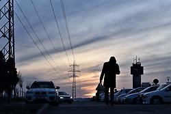 March 28, 2019 - Ankara, Turkey - A man walks towards a parking lot during sunset. (Credit Image: © Altan Gocher/ZUMA Wire)