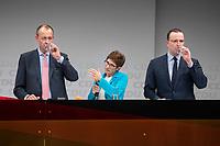 30 NOV 2018, BERLIN/GERMANY:<br /> Friedrich Merz (L), CDU, Rechtanwalt und ehem. stellv. CDU/CSU Fraktionsvorsitzender, Annegret Kramp-Karrenbauer (M), CDU Generalsekretaerin, und Jens Spahn (R), CDU, Bundesgesundheitsminister, waehrend der Fragerunden der Teilnehmer,  Regionalkonferenz der CDU zur Vorstellung der Kandidaten fuer das Amt des Bundesvorsitzenden der CDU, Estrell Convention Center<br /> IMAGE: 20181130-01-045<br /> KEYWORDS: trinken, trinkt, Wasser