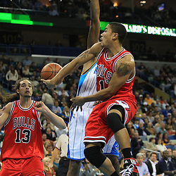 04 February 2009:  Chicago Bulls guard Derrick Rose (1) passes to Joakim Noah (13) as New Orleans Hornets forward James Posey (41) defends the play during a 93-107 loss by the New Orleans Hornets to the Chicago Bulls at the New Orleans Arena in New Orleans, LA.