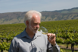 California, San Luis Obispo County: Winemaker Harry Hansen at Edna Valley Vineyards, noted for his Chardonnay. Model released..Photo caluis102-70756..Photo copyright Lee Foster, www.fostertravel.com, 510-549-2202, lee@fostertravel.com