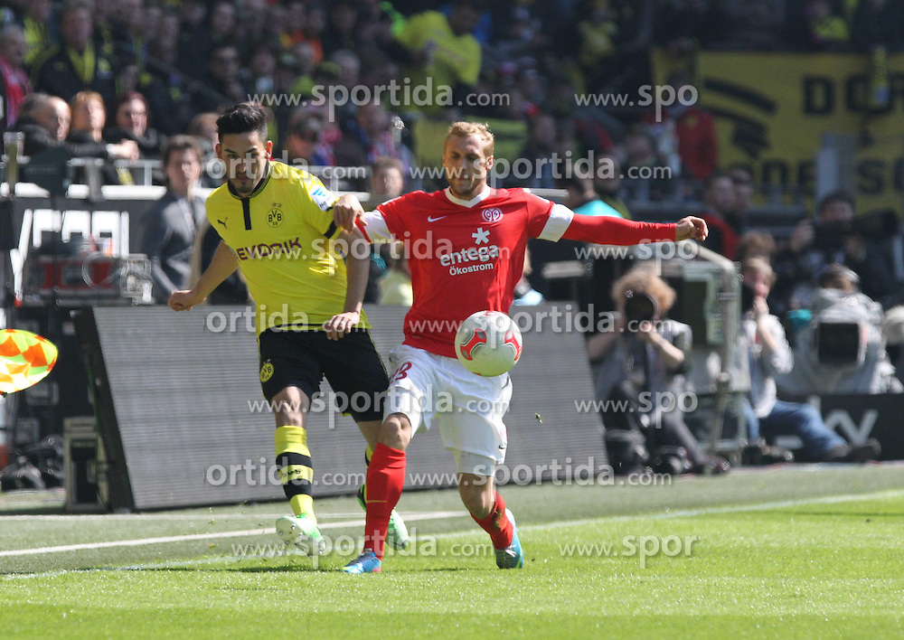 20.04.2013, Signal Iduna Park, Dortmund, GER, 1. FBL, Borussia Dortmund vs 1. FSV Mainz 05, 30. Runde, im Bild Nikita RUKAVYTSYA #13 (FSV Mainz 05) gegen Ilkay GUENDOGAN #8 (Borussia Dortmund)/ Zweikampf/ Aktion / Action,, / // during the German Bundesliga 30 th round match between Borussia Dortmund and 1. FSV Mainz 05 at the Signal Iduna Park, Dortmund, Germany on 2013/04/20. EXPA Pictures © 2013, PhotoCredit: EXPA/ Eibner/ Schueler..***** ATTENTION - OUT OF GER *****