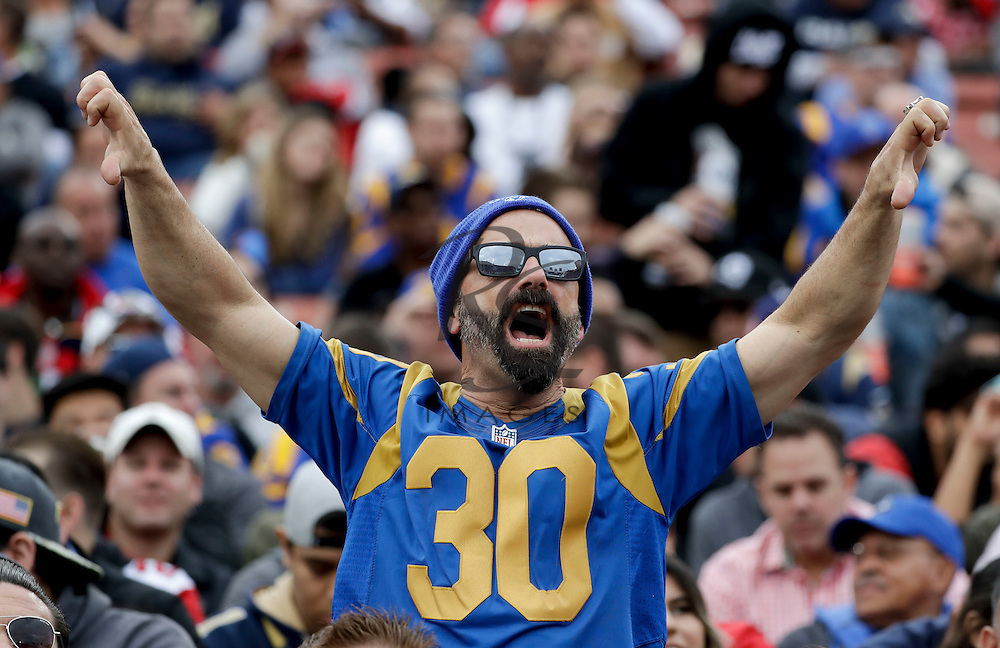 A Los Angeles Rams fans yells during the first half of an NFL football game against the Atlanta Falcons Sunday, Dec. 11, 2016, in Los Angeles. (AP Photo/Rick Scuteri)