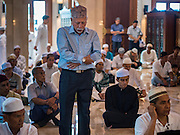 17 JULY 2015 - BANGKOK, THAILAND:     A man prays in Ton Son Mosque during services marking Eid al-Fitr. Eid al-Fitr is also called Feast of Breaking the Fast, the Sugar Feast, Bayram (Bajram), the Sweet Festival or Hari Raya Puasa and the Lesser Eid. It is an important Muslim religious holiday that marks the end of Ramadan, the Islamic holy month of fasting. Muslims are not allowed to fast on Eid. The holiday celebrates the conclusion of the 29 or 30 days of dawn-to-sunset fasting Muslims do during the month of Ramadan. Islam is the second largest religion in Thailand. Government sources say about 5% of Thais are Muslim, many in the Muslim community say the number is closer to 10%.          PHOTO BY JACK KURTZ