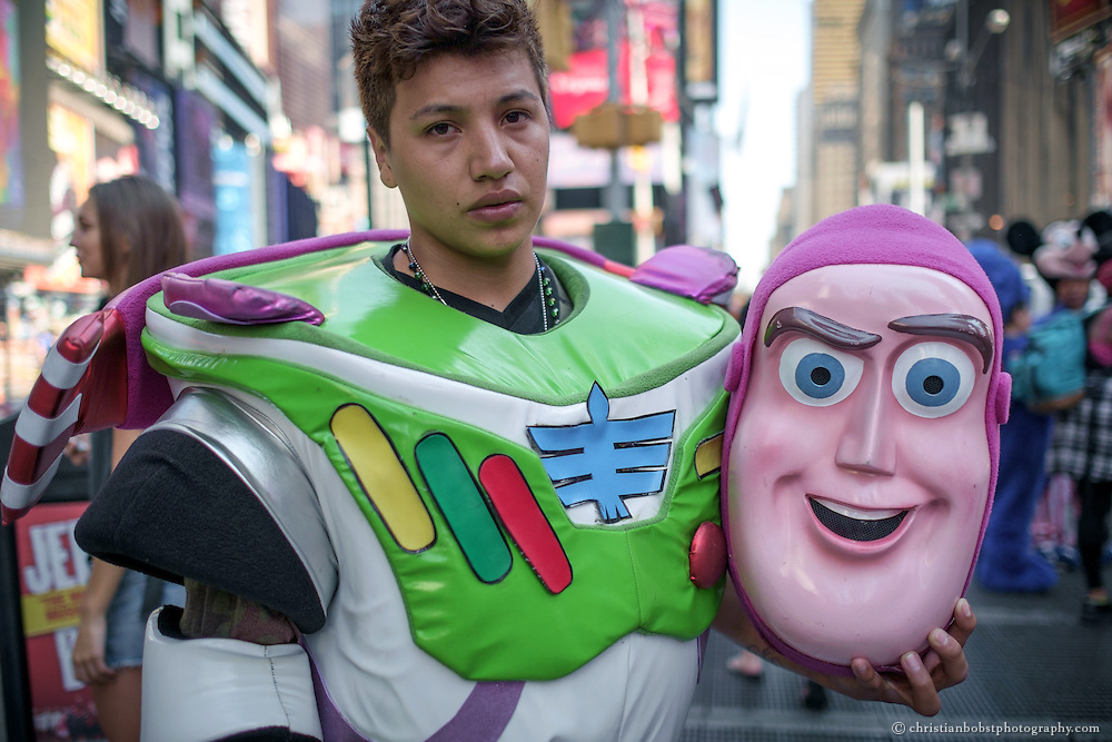 Joshua alias Buz Lightyear takes a break from his work as a costumed character at New York´s Times Square.