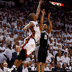Jun 18, 2013; Miami, FL, USA; Miami Heat center Chris Bosh (1) blocks the shot of San Antonio Spurs point guard Tony Parker (9) in overtime of game six in the 2013 NBA Finals at American Airlines Arena. The Heat won 103-100 in overtime. Mandatory Credit: Derick E. Hingle-USA TODAY Sports