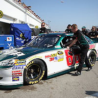 Sprint Cup Series driver Dale Earnhardt Jr. (88) gets help into his garage at Daytona International Speedway on February 18, 2011 in Daytona Beach, Florida. (AP Photo/Alex Menendez)